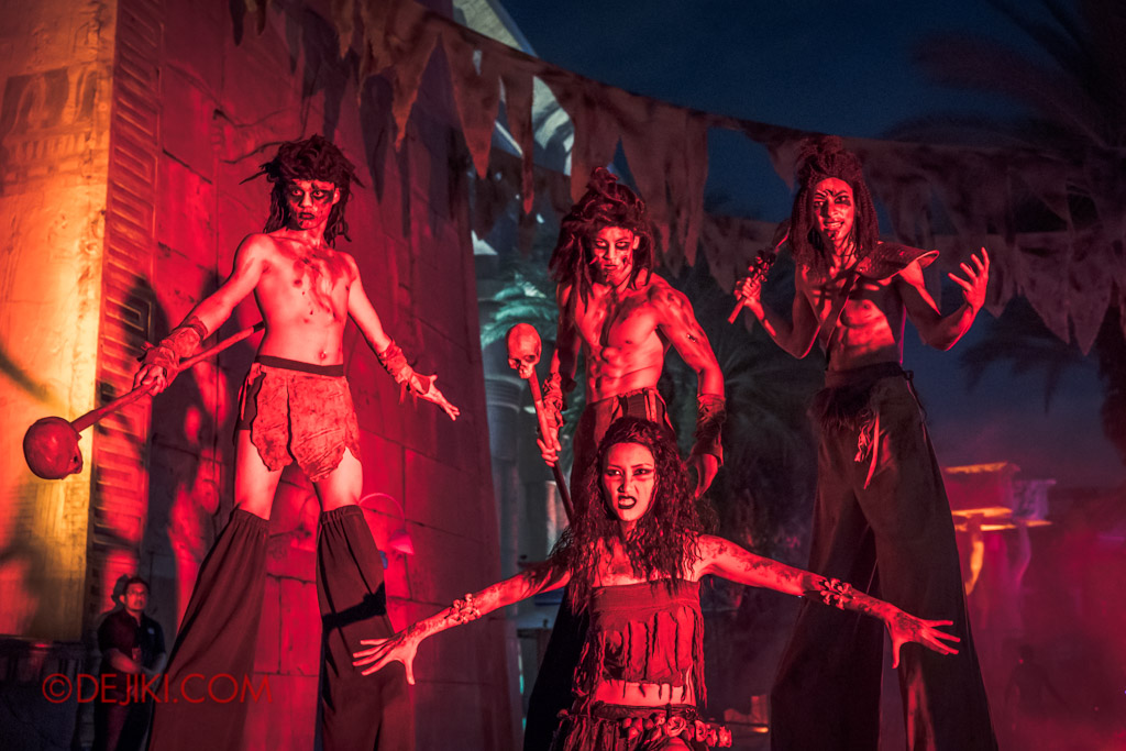 USS Singapore Halloween Horror Nights 8 Cannibal scare zone group stilt walkers with belly dancer