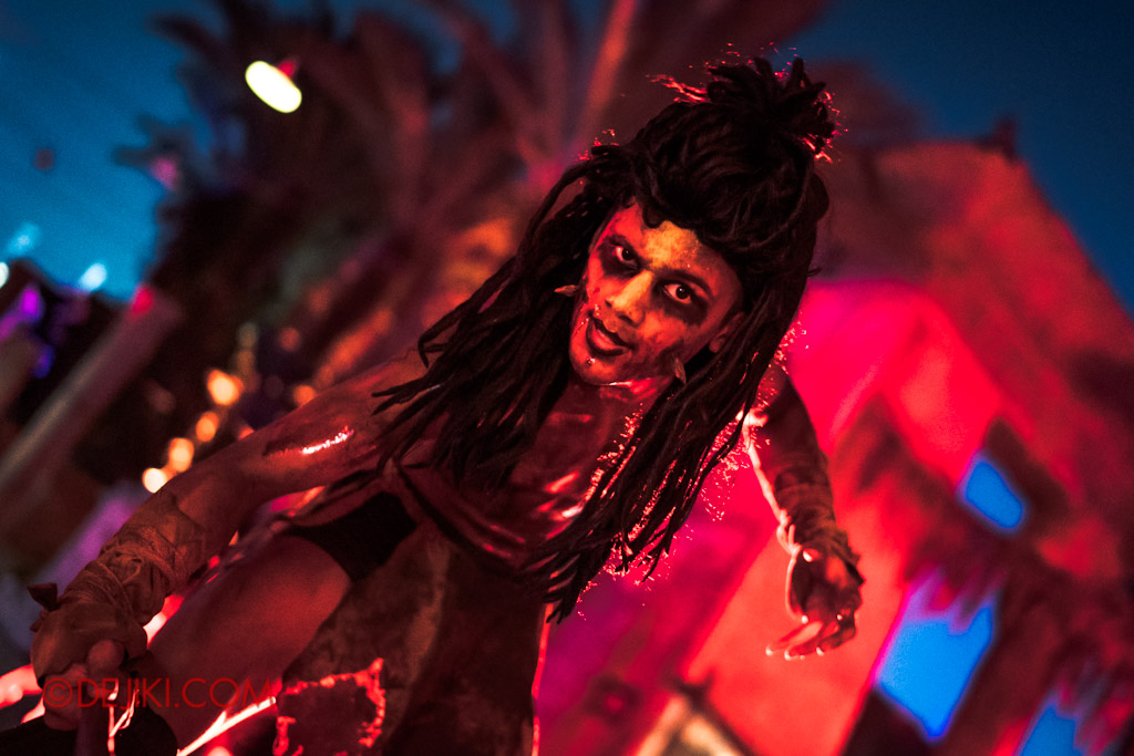 USS Singapore Halloween Horror Nights 8 Cannibal scare zone stilt walker with dreadlocks