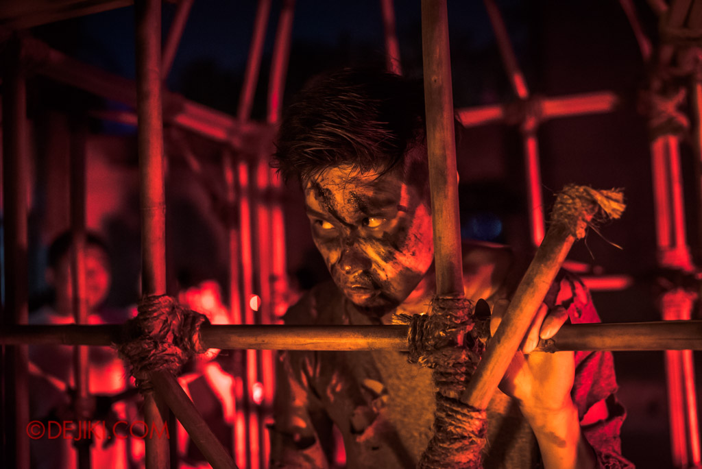 USS Singapore Halloween Horror Nights 8 Cannibal scare zone victim trapped in cage reginald
